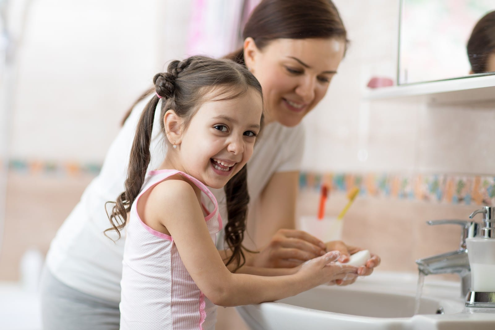 Mother and Daughter washing their hands