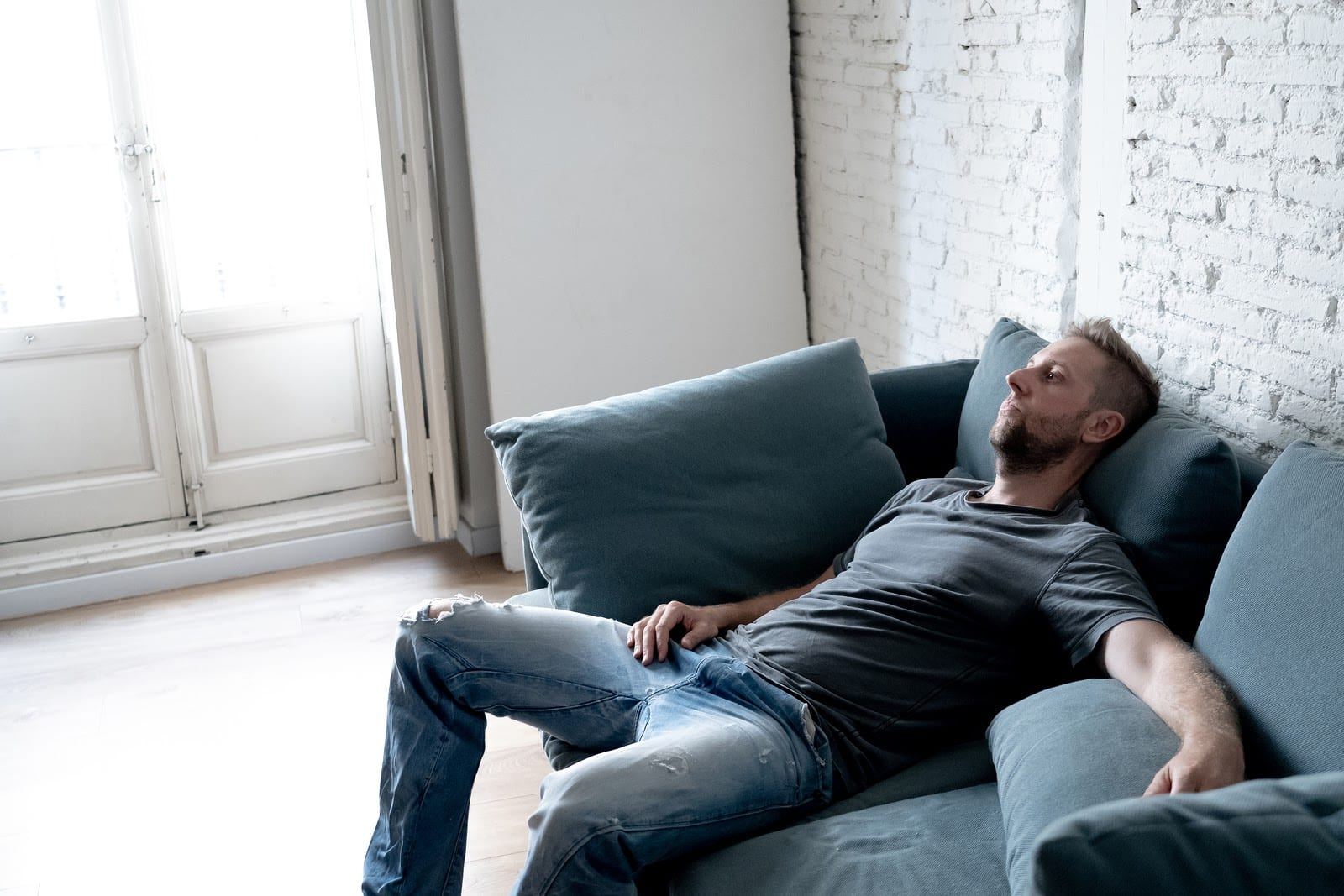 depressed man sitting on a couch