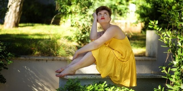 Depressed Woman in Yellow Dress