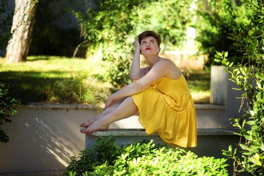 Depressed Woman in Yellow Dress